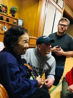 Filmmakers chatting with the 94 years old grannie at her home